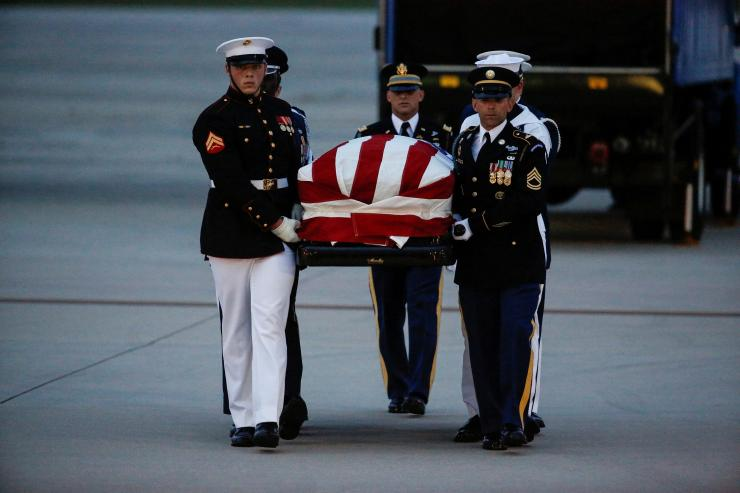 The casket containing the remains of Senator John McCain (R-AZ) is carried by honor guards at Joint Base Andrews in Maryland, U.S., August 30, 2018.