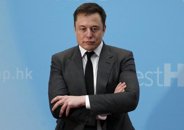FILE PHOTO: Tesla Chief Executive Elon Musk stands on the podium as he attends a forum on startups in Hong Kong, China January 26, 2016.
