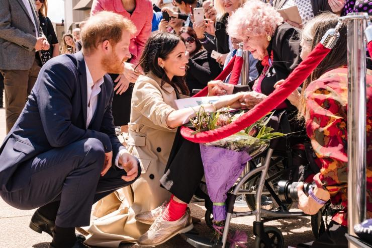 Prince Harry introduces Meghan Markle to Daphne Dunne in Sydney, Australia, October 16, 2018.