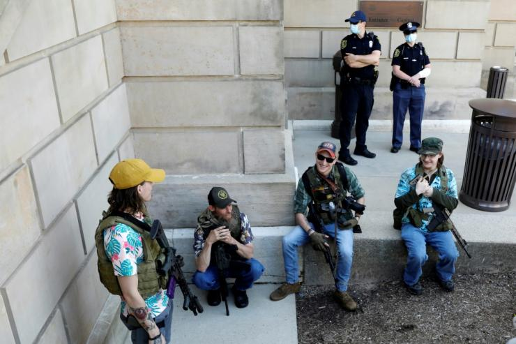 Armed protesters demonstrate outside the Michigan State Capitol in Lansing, Michigan