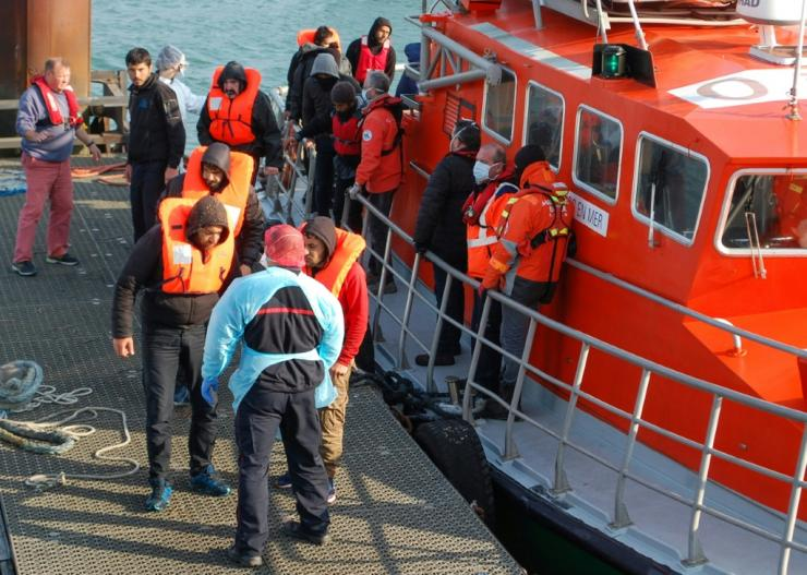 Migrants disembark from a life boat after being rescued off the coast of Calais. The coronavirus pandemic has seen more attempt the crossing, with fewer trucks going through the Channel Tunnel