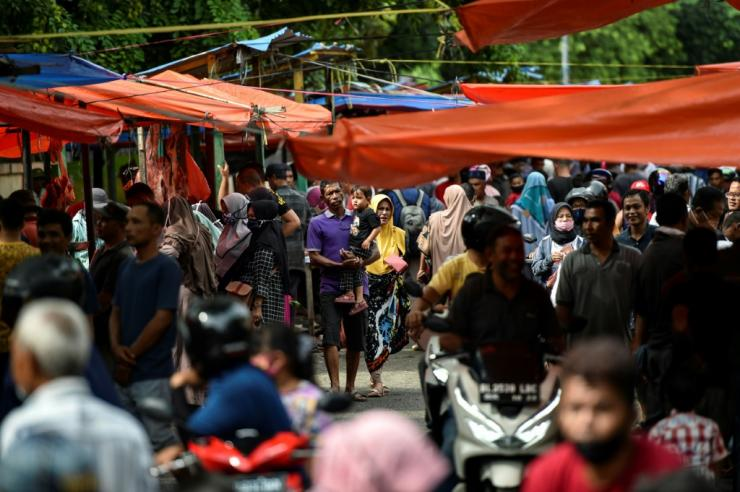 Muslims across Asia -- from Indonesia to Pakistan, Malaysia and even war-ravaged Afghanistan -- thronged markets for pre-festival shopping, flouting coronavirus guidelines