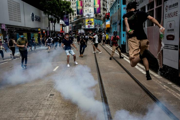Riot police fired tear gas to disperse the protesters
