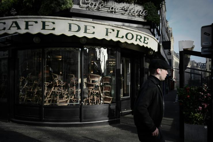 A man walks past the closed Cafe de Flore in Paris in March 2020 -- restaurants and cafes will be allowed to serve some customers on outside terraces from June 2, 2020