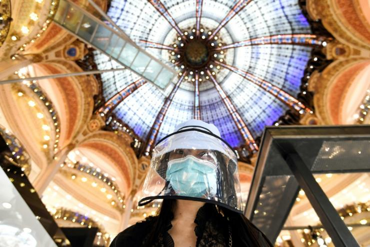 A shopper at Paris's famed Galeries Lafayette department, which reopened on Saturday