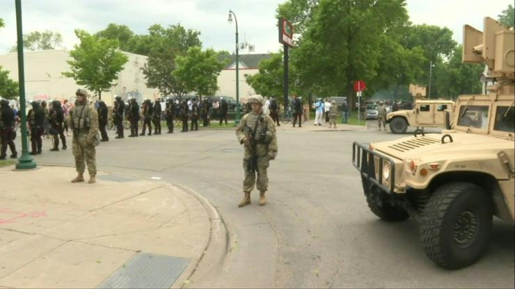 IMAGES National Guard soldiers are deployed in Minneapolis for peacekeeping after a third night of rioting over police brutality against African Americans left hundreds of shops damaged and a police station on fire.