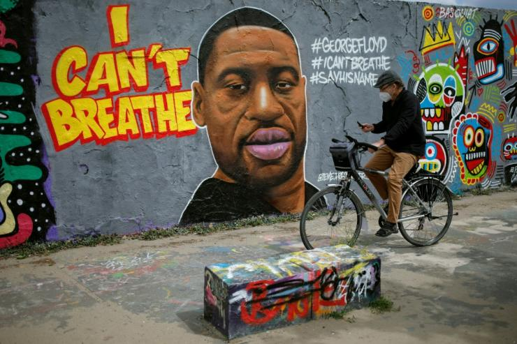 A mural in Berlin honors George Floyd, a black man whose killing in Minneapolis by a white police officer unleashed protests across the United States