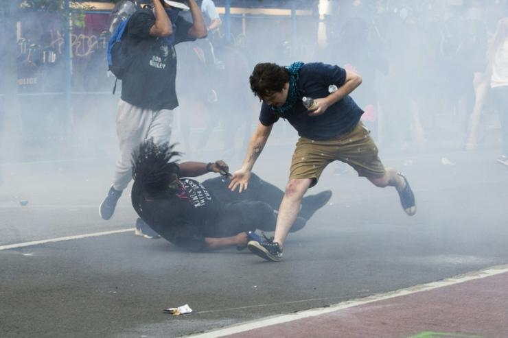 Protestors are tear-gassed as the police disperse them near the White House on June 1, 2020