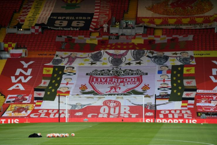 Liverpool's famous Kop end was draped in flags for Anfield's return behind closed doors