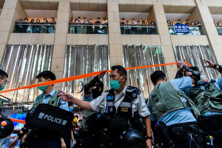 Police enter a shopping mall to disperse people attending a lunchtime rally in Hong Kong, on the day China passed a sweeping national security law for the city