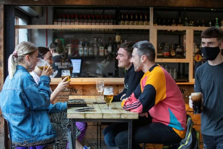 Pubs in Northern Ireland began serving again on Friday while English pubs reopen on what is being dubbed 'Super Saturday'