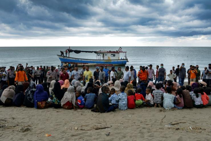 Evacuated Rohingya people from Myanmar sit on the shorelines of an Indonesian village
