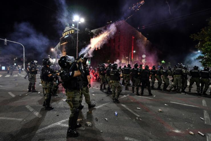 Police fire tear gas in Belgrade on Friday night during the protest against the government's handling of the pandemic