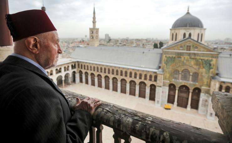 A March 12 file photo shows Mohammad Ali al-Sheikh, the eldest of the muezzins who call Muslims to prayer, on a balcony of the Umayyad Mosque in the ancient quarters of Damascus
