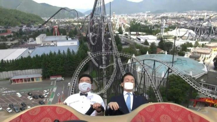 "It might be the unlikeliest instructional video ever, but footage of two Japanese amusement park executives demonstrating how to ""scream inside your heart"" to avoid spreading COVID-19 while on a rollercoaster has been a roaring success"