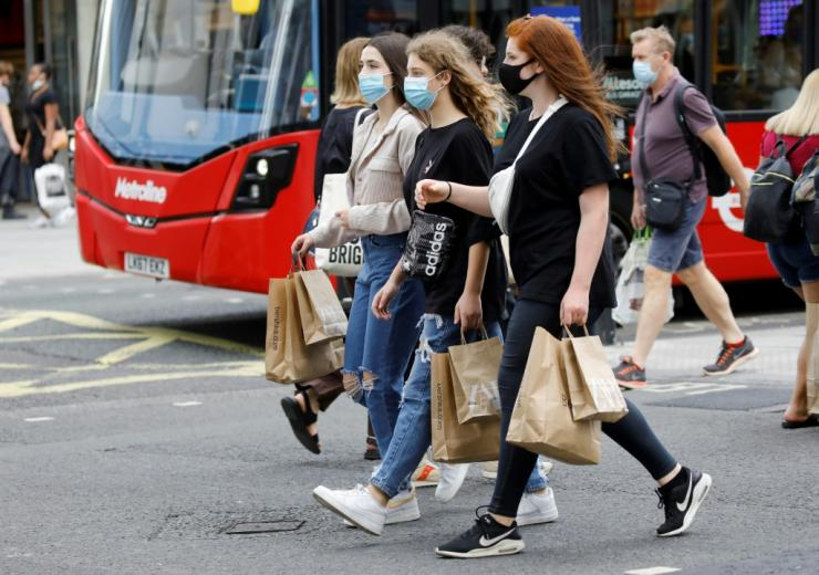 Shoppers wear face masks on Oxford Street in London after face coverings became mandatory in shops and supermarkets in Britain