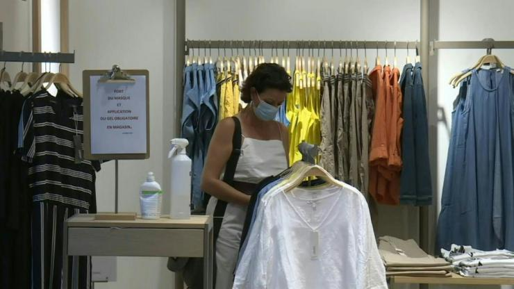 IMAGES Geneva residents wear masks in shops as face coverings become compulsory in all shops across the canton of Geneva. The measure had already been implemented in other Swiss cantons.
