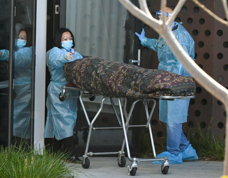 The body of a resident is removed from the Epping  Gardens care home. Nursing homes in Melbourne have been at the centre of a recent outbreak, with more than 800 infections among residents and staff