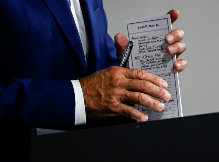 "US Presidential candidate and former Vice President, Joe Biden holds a pad with potential Vice Presidential names on it and other notes, during a campaign event at the William ""Hicks"" Anderson Community Center in Wilmington, Delaware on July 28, 2020."