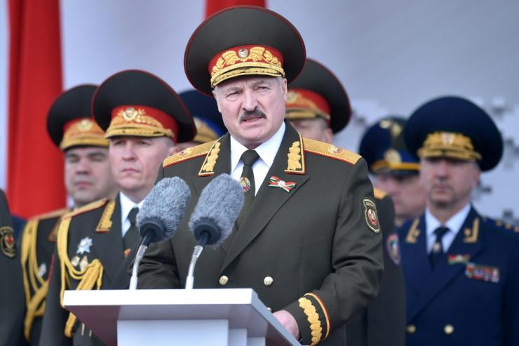 Lukashenko, shown here at a military parade in May, has warned of outside threats and raised the spectre of violent mobs