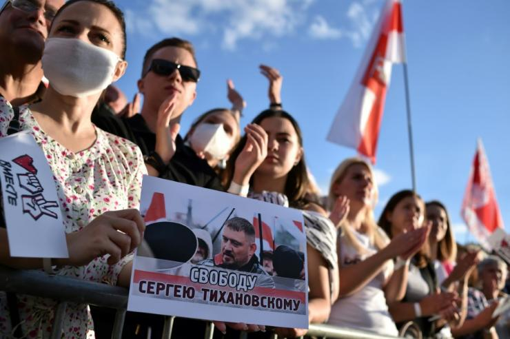 A woman in Minsk holds up a placard reading 'Freedom to Sergei Tikhanovsky' at a campaign rally for the jailed blogger's wife, presidential candidate Svetlana Tikhanovskaya, last month