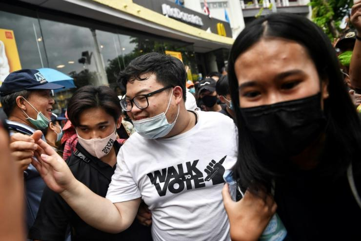 Thai activist Parit 'Penguin' Chirawak also participated in the rally, flanked by cheering supporters