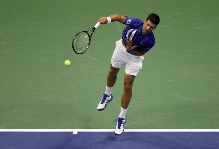 Novak Djokovic of Serbia serves during his Men's Singles first round match against Damir Dzumhur of Bosnia and Herzegovina on Day One of the 2020 US Open at the USTA Billie Jean King National Tennis Center on August 31, 2020