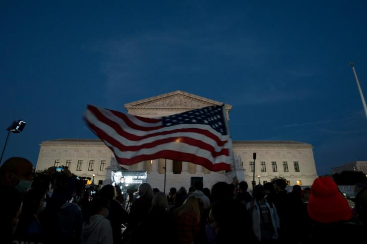 A US flag outside the Supreme Court in Washington as crowds gathered to pay respects to late justice Ruth Bader Ginsburg