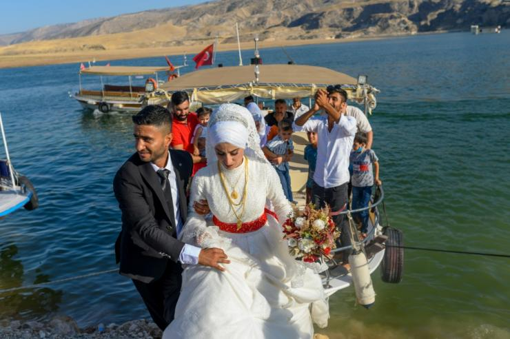 Cetin Yildirimer, a 29-year-old former tour guide, celebrated on a boat with his new wife before the couple move into one of the homes built for the original town's residents.