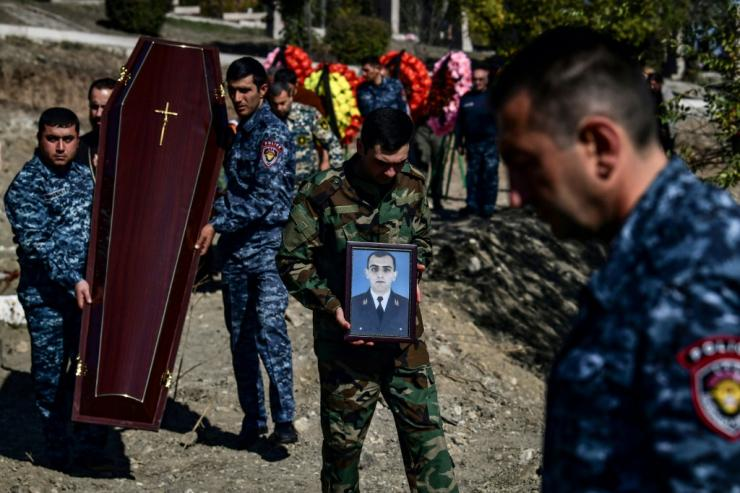 The newly dead were buried alongside the graves of soldiers killed in the first war over Karabakh