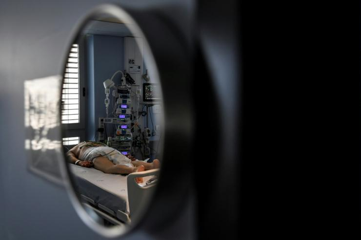 A patient in a coronavirus intensive care unit at the Sao Joao Hospital in Portugal's Porto