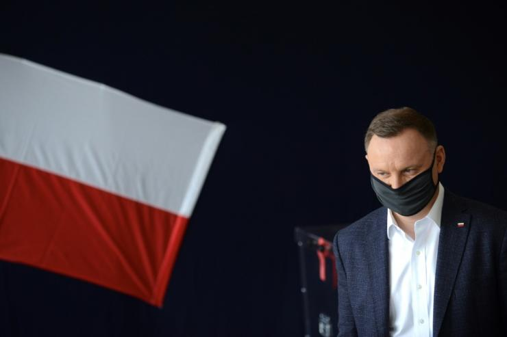 Polish President Andrzej Duda arrives at a polling station in Krakow on June 28 to vote during Poland's Presidental election.