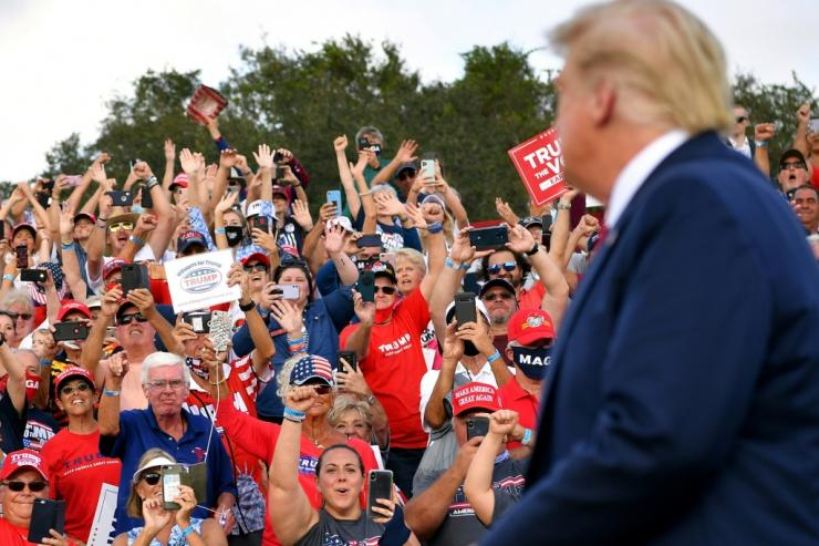 Supporters cheer US President Donald Trump at The Villages, a retirement community in Florida