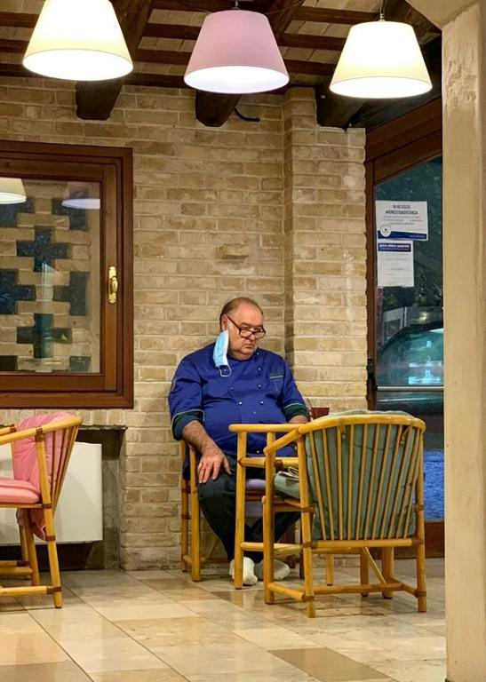 A photo of dejected restaurant owner Giuseppe Tonon went viral in Italy