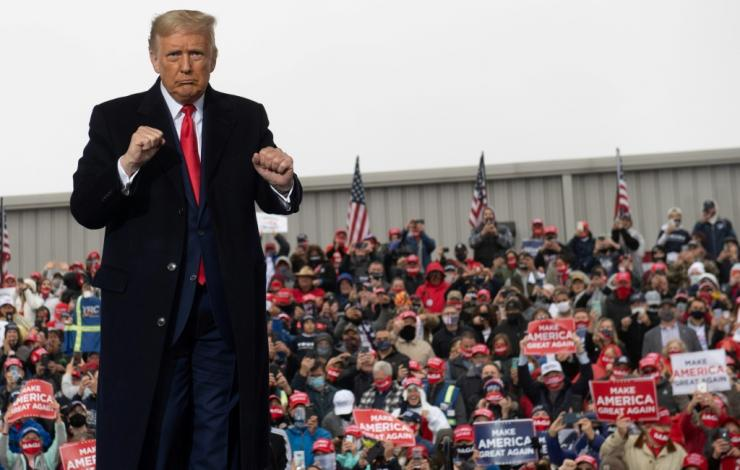 US President Donald Trump, seen here at a rally in Pennsylvania on Monday, claimed the US was 'rounding the corner'.