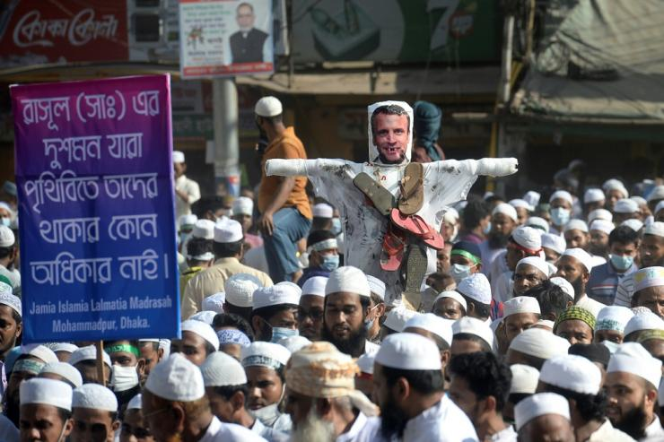 Muslim worshippers came out of Friday prayers in mosques across the Bangladeshi capital and some burned an effigy of French President Emmanuel Macron