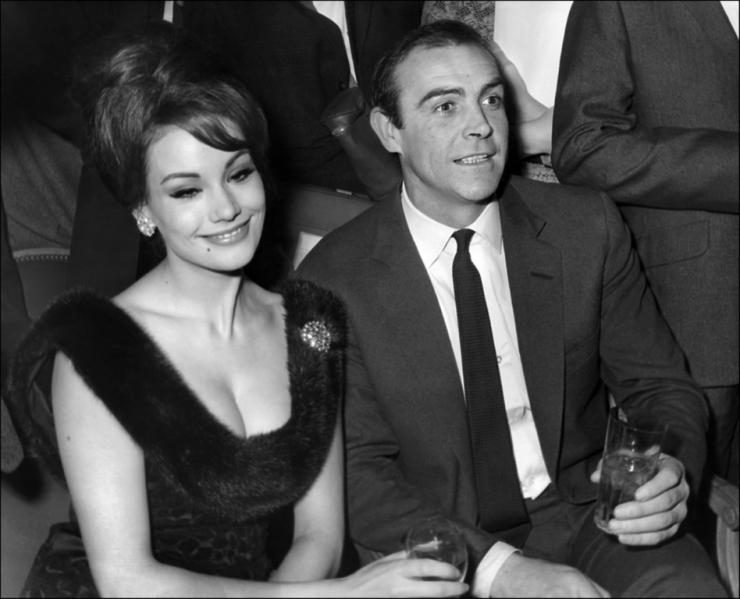 In this file photo taken on February 19, 1965 Scottish actor Sean Conner (R) and his partner Claudine Auger (L) answer journalists' questions in Paris.