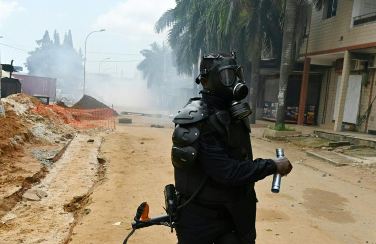 Ivorian anti-riot police fired tear has to break up opposition protesters in Blockhauss district in Abidjan