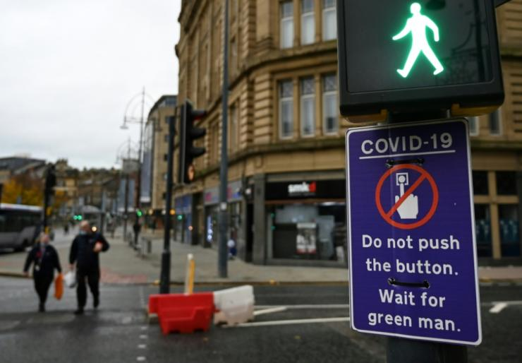 Pedestrians in the northern English town of Bradford are asked to not even press the button at a pedestrain crossing, for fear of spreading the virus