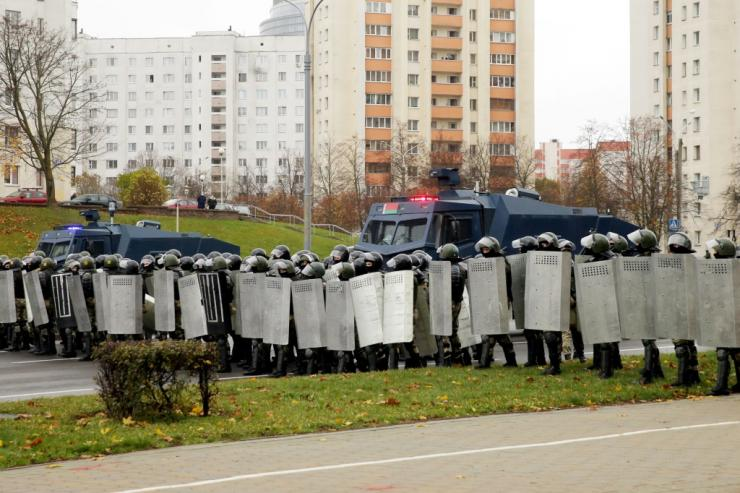 Law enforcement officers block the road as opposition supporters hold their latest rally to protest the Belarus presidential election results three months ago.