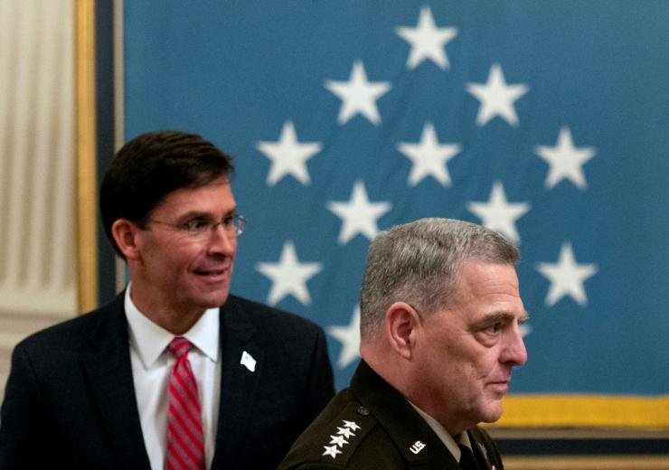 At the White House ceremony on September 11, 2020, Joint Chiefs of Staff Chairman Mark Milley (right) and Secretary of Defense Mark Esper were both cautious about accelerating their withdrawal from Afghanistan.