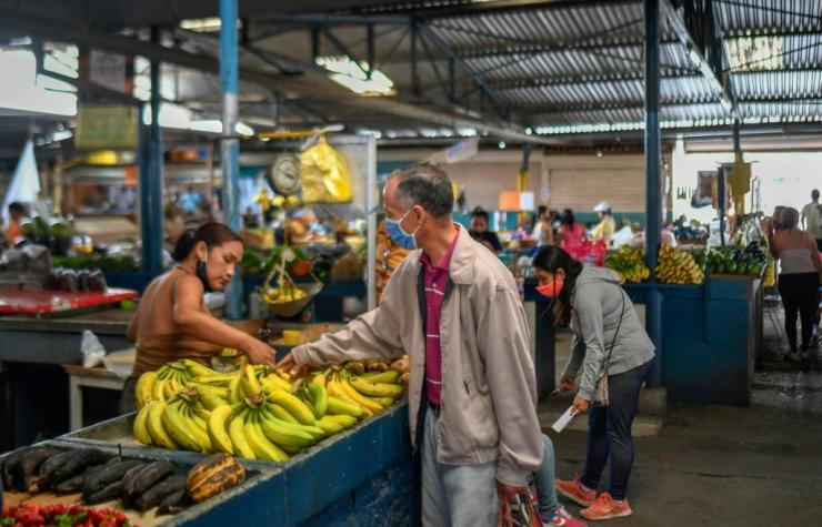 A man buy bananas at the municipal market of Chacao in Caracas amid the coronavirus pandemic on September 3, 2020 as inflation increases in Venezuela, which is in the midst of the worst economic crisis in its history
