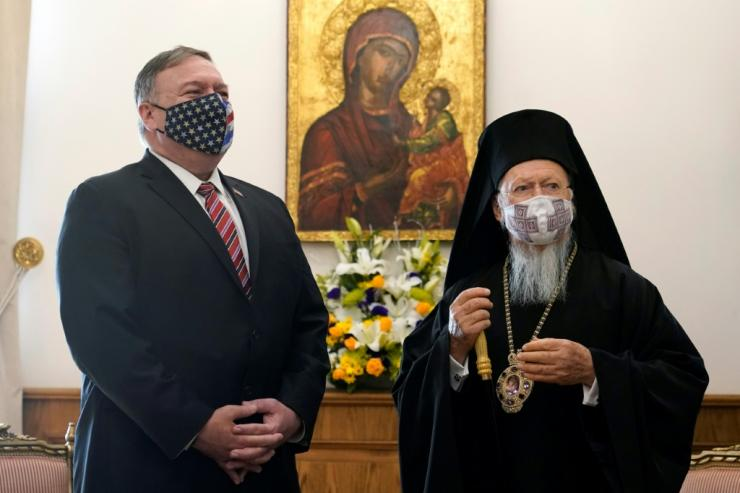 U.S. Secretary of State Mike Pompeo (L) listens to Ecumenical Patriarch Bartholomew I