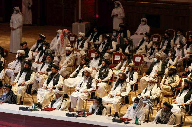 Peace talks between the Afghan government and the Taliban opened in September in Doha; here Taliban delegates listen during the opening session