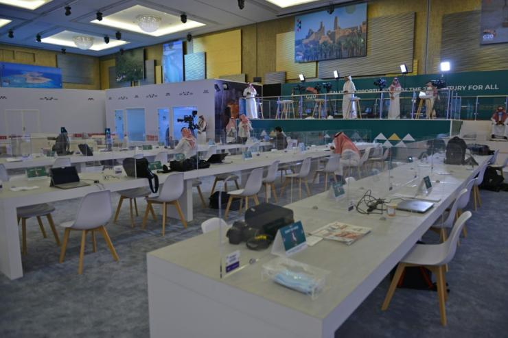 Journalists work in an almost empty media room set up for the coverage of the G20 summit,  held virtually due to the  coronavirus pandemic, in the Saudi capital Riyadh, on November 20, 2020