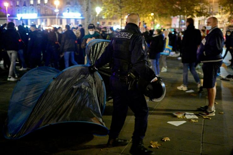 Police removed the tents, sometimes with people still inside, in the face of protests from migrants and jeers from activists