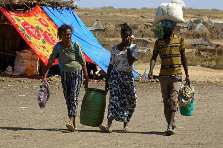 Ethiopian refugees walk through a transit centre at the Sudanese border town of Hamdayit on Thursday.Over 43,000 refugees have crossed into Sudan since fighting broke out in Tigray on November 4, the UN says