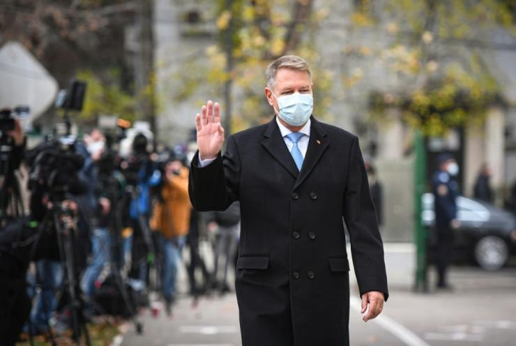 Romanian President Klaus Iohannis arrives to vote at a polling station in Bucharest