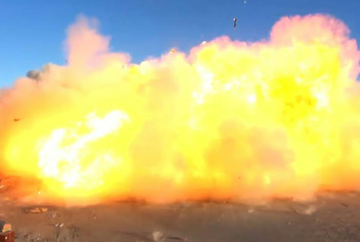 This SpaceX video frame grab shows the Starship SN8 rocket prototype crashing on landing at the company's Boca Chica, Texas test site