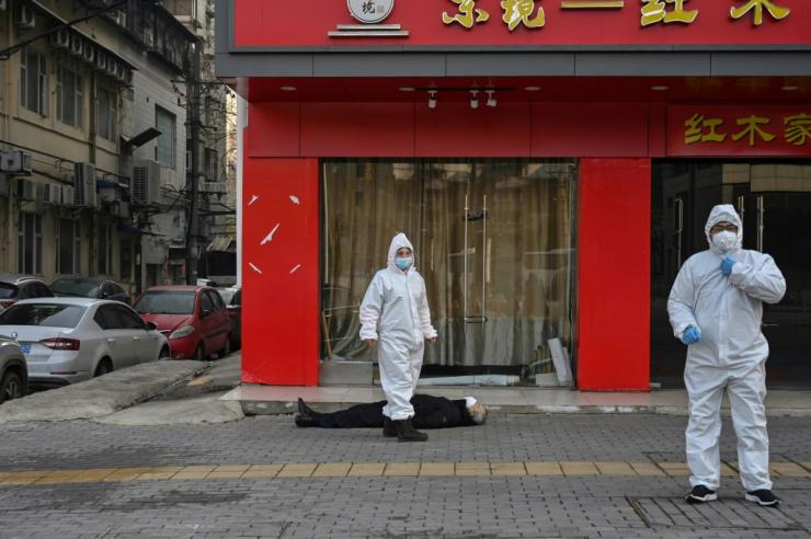 AFP images of a man lying dead outside a Wuhan furniture shop, wearing a face mask, came to encapsulate the fear in the city. AFP could not confirm how he had died